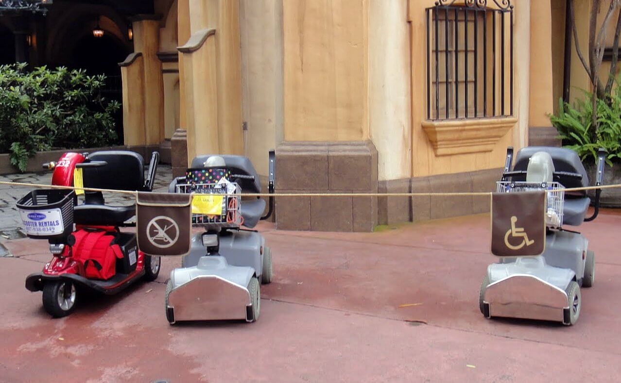 Using a wheelchair mobility scooter or ecv on a theme for Motorized scooter rental disneyland