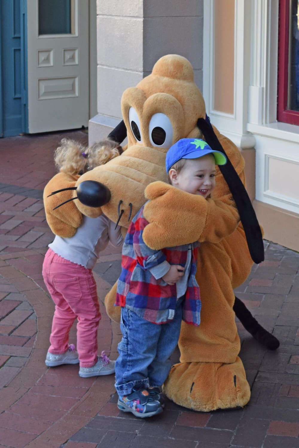 Easy-Does-It Tips to Help a Child Afraid of Disney Characters - Pluto