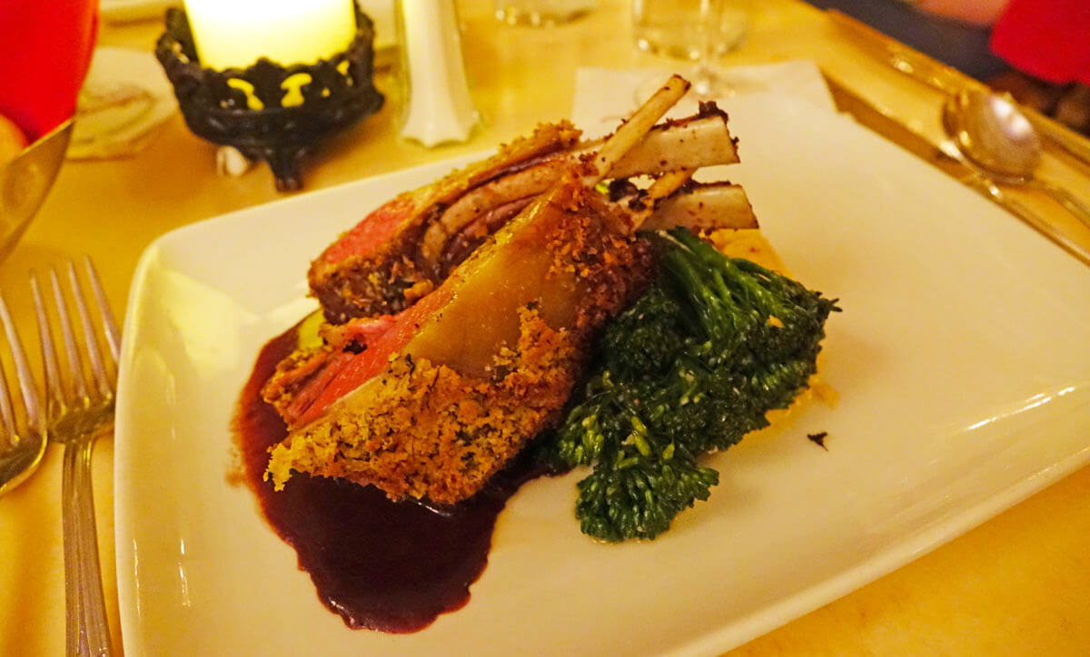 Reservation at Be Our Guest - Herb-crusted lamb