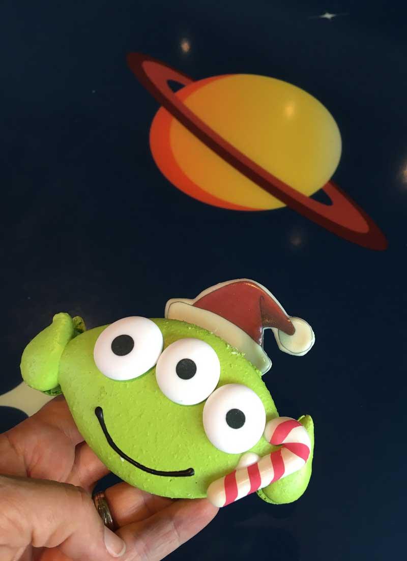 Holiday Treats at Disneyland - Green Alien Macaron in Santa Hat