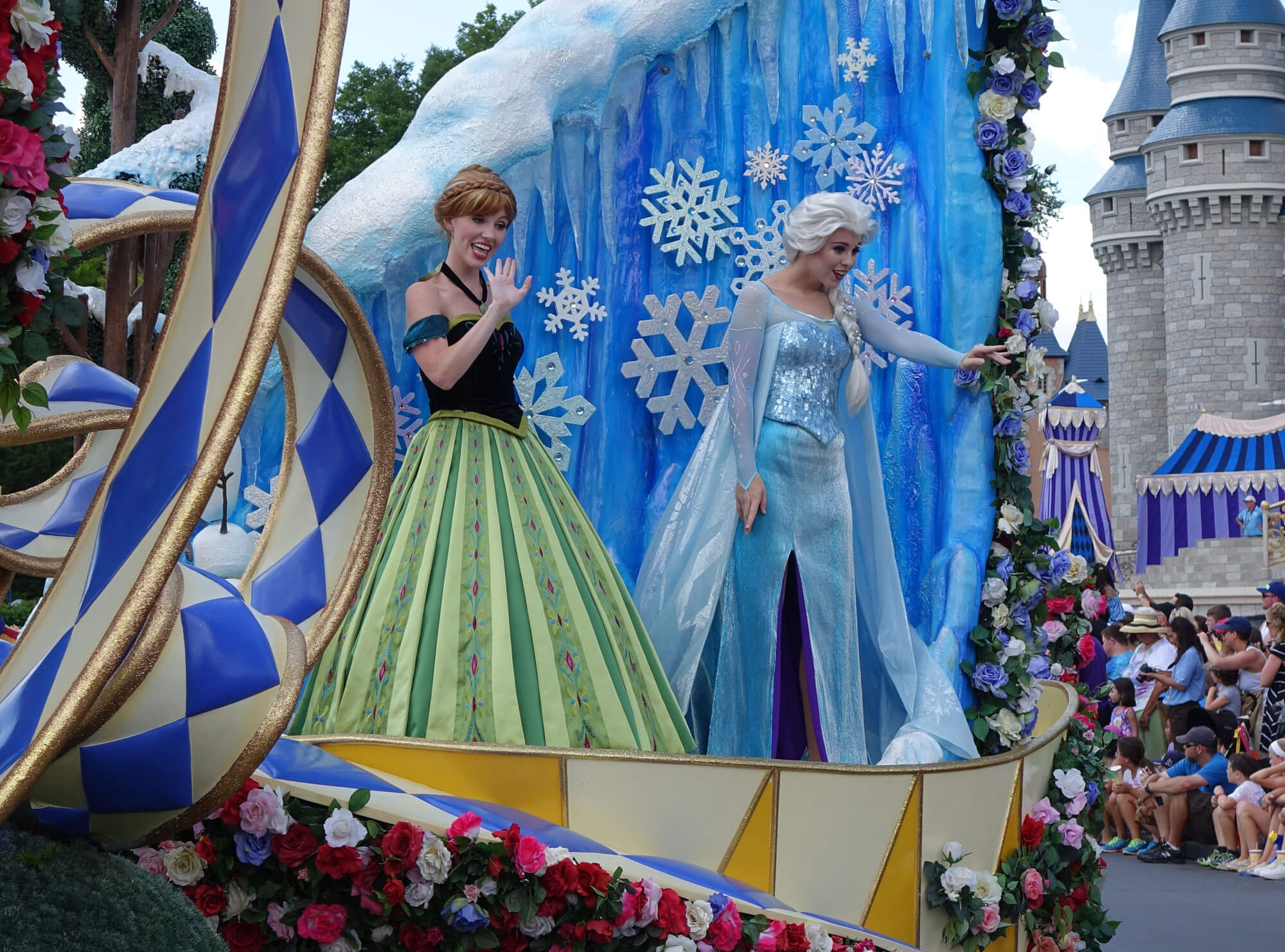Celebrating a Birthday at Disney World - Elsa and Anna in parade