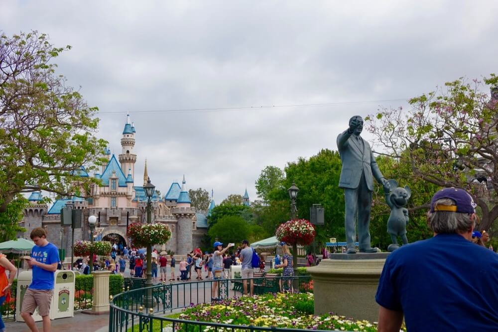 Maximize Your Time at Disneyland - Disneyland Partners Statue