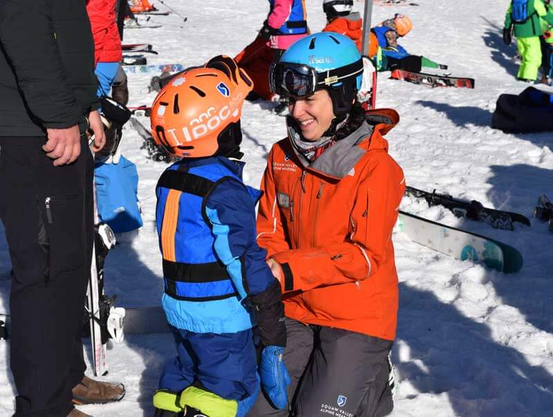 Ski Mom Secrets for New Skiers - Mom with Child