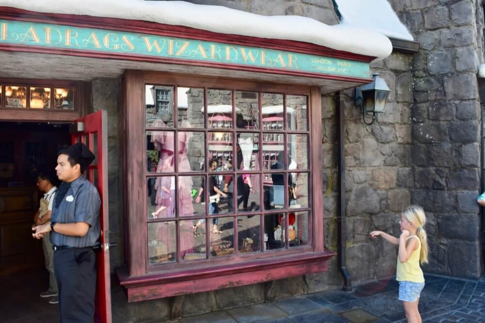 Entertaining Small Children at Universal Studios Hollywood - Girl Using Interactive Wand at Wizarding World