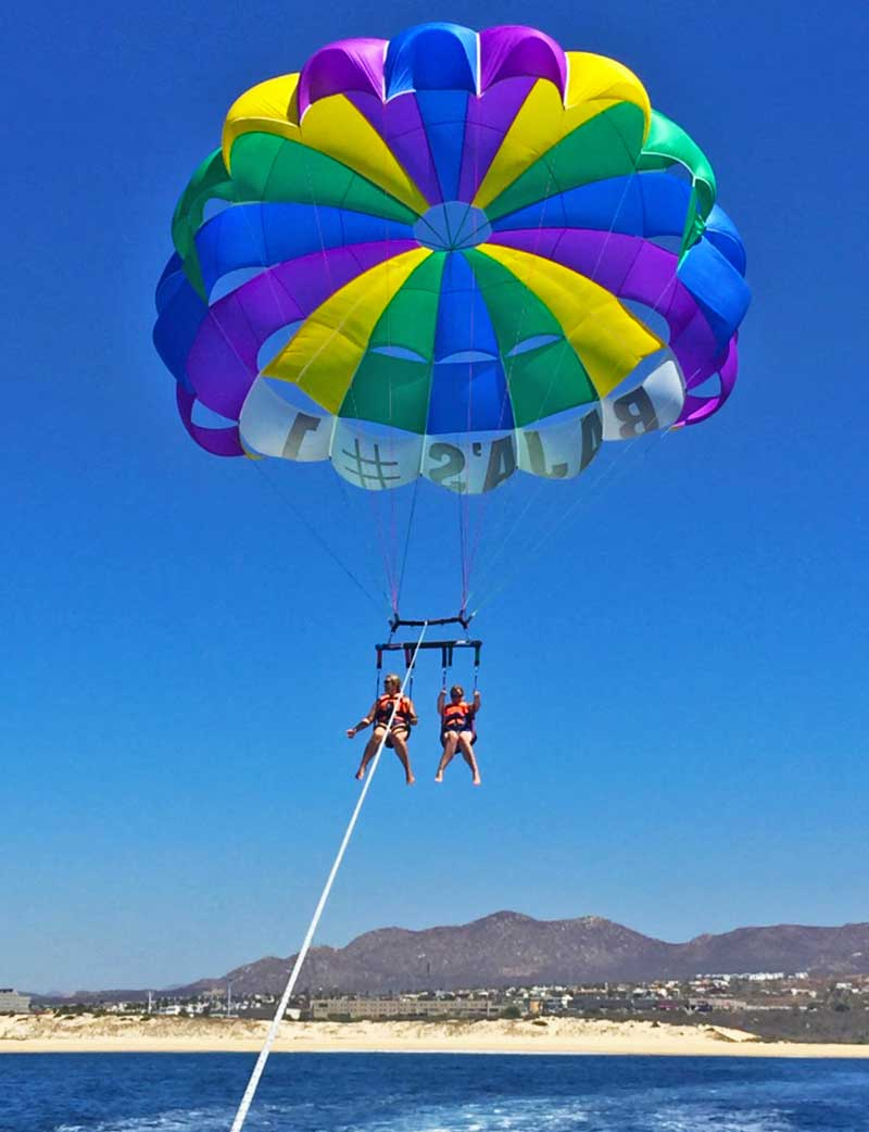 Tips for a Great Beach Vacation with Kids - Parasailing