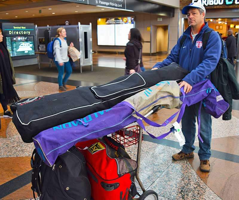 Ways to Save When Flying to Colorado - Airport Cart