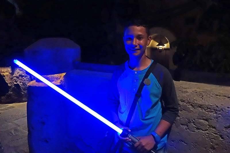 Build a Lightsaber at Savi's Workshop - Kid with Lightsaber