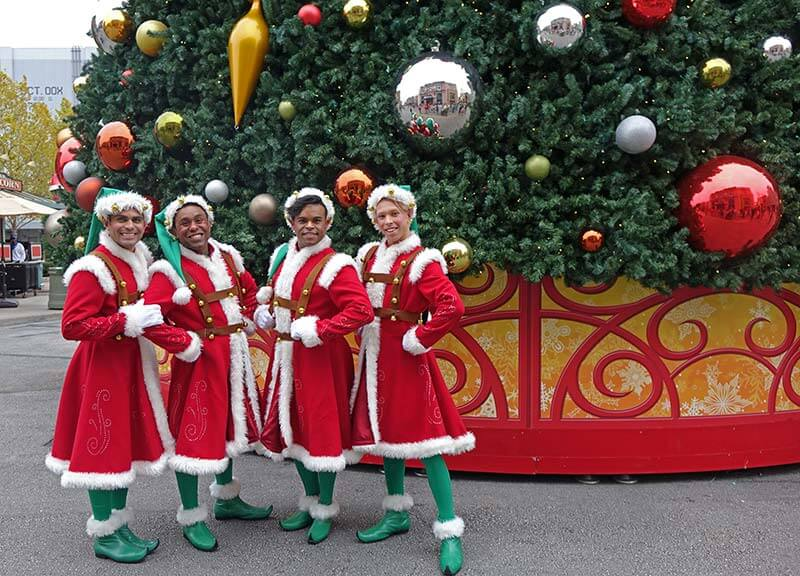 Universal Studios Christmas - Santa's Helpers in Front of Tree
