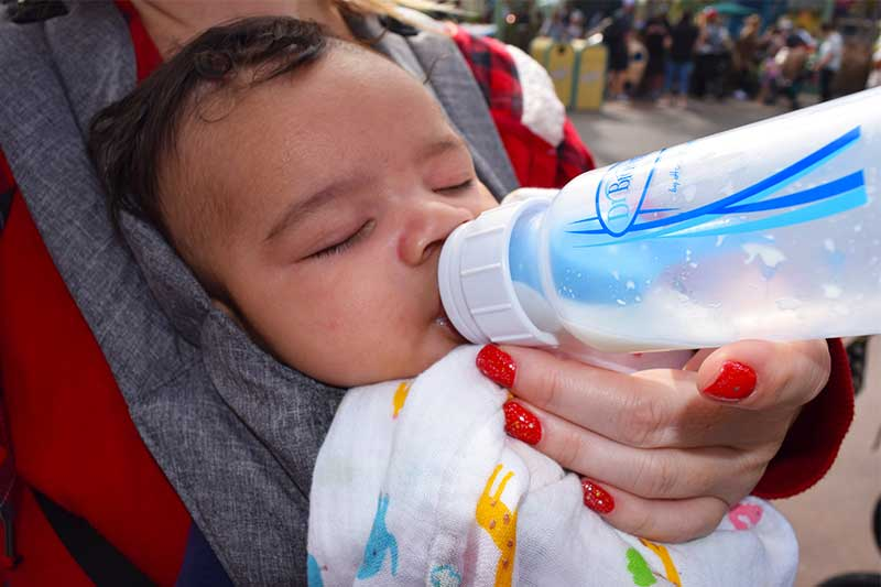 Mom's Secrets for Going to Disneyland with a Baby-Bottle and carrier