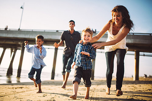 Los Angeles Family Playing on Beach