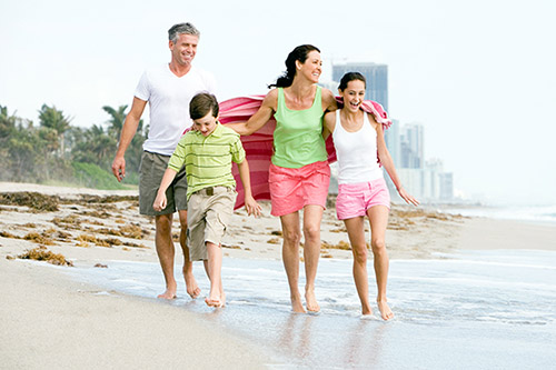 Miami family walks on beach
