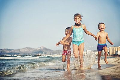 Miami kids running on sand