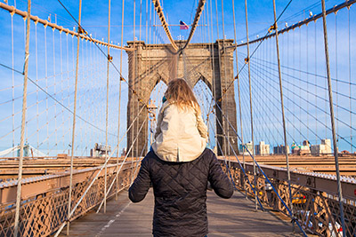 New York City father and daughter on Brooklyn Bridge