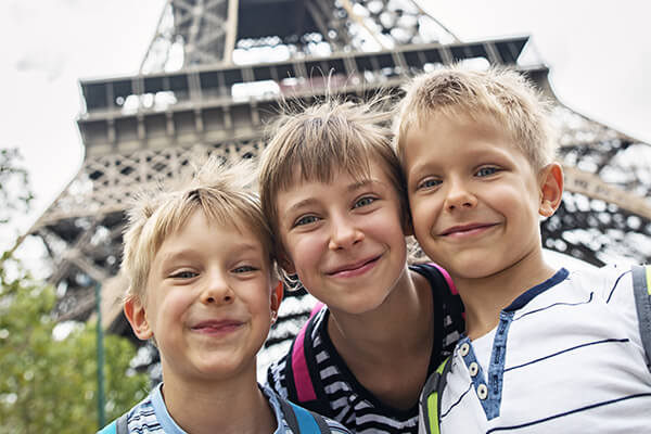 Paris kids in front of Eiffel Tower
